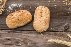 Rustic baguette and wheat Royalty Free Stock Images