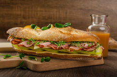 Rustic baguettes with smoked rump Royalty Free Stock Photography