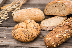 Rustic bakery and wheat on an old vintage wood table. Royalty Free Stock Images