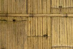 Brown bamboo fence background. Rustic bamboo wall background,vintage wood royalty free stock photos