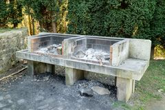 Rustic barbecue in a public park stock photography