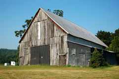 Rustic Barn. Old abandoned barn on a horse farm royalty free stock image