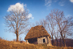 Rustic Barn. A rustic barn on top of the Bedeleu mountain, Salciua, Alba, Romania, under the early spring afternoon sun Royalty Free Stock Photo