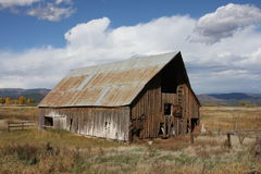 Rustic Barn in Colorado on a Cool Cloudly Day Stock Photo