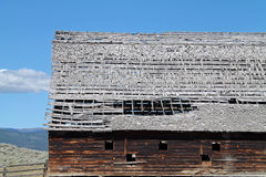 Rustic Barn with Dilapidated Roof in Sagebrush Country Royalty Free Stock Images