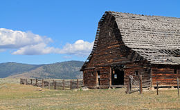 Rustic Barn with Dilapidated Roof in Sagebrush Country Royalty Free Stock Image