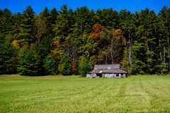 Rustic barn in fall field Stock Images