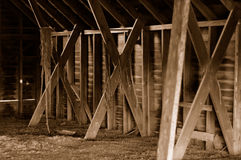 Rustic barn interior. Rustic old barn interior in sepia tone Royalty Free Stock Photography