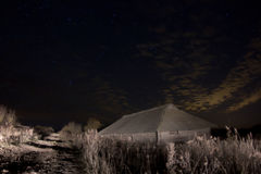 Rustic barn on a moonlit night royalty free stock image