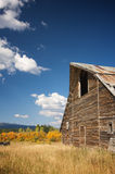 Rustic Barn Scene. With Deep Blue Sky and Clouds stock photography