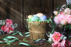 Free Rustic Basket Of Easter Eggs Royalty Free Stock Image - 111130366