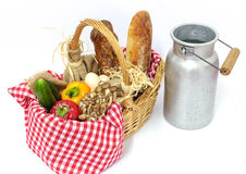 Rustic basket with vegetables, bread and eggs, and milk jug old Royalty Free Stock Photography