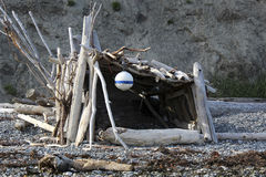 Rustic beach hut. Made of driftwood with a float as decoration Stock Photo