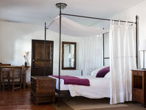 Rustic bedroom in luxury hotel Stock Images