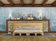 Rustic bedroom with pallet double bed Royalty Free Stock Photography