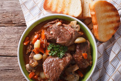 Rustic Beef Bourguignon in a bowl on a table close-up. horizonta Royalty Free Stock Image