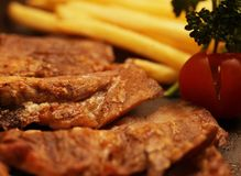 Rustic beefsteak with french fries Royalty Free Stock Images