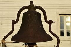 Rustic Bell. A large rustic bell possibly used for church or school in front of the Sanford House at Old World Wisconsin in Eagle, WI Stock Photography