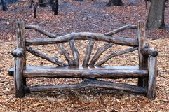 Rustic Bench in Central Park New York City. A rustic bench on a wet winter day in Central Park in New York City Royalty Free Stock Images