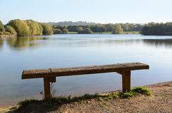 Rustic bench by a lake Stock Photos