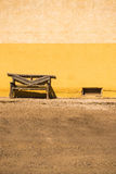 Rustic bench next to painted wall Stock Photo
