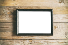 Rustic black frame mock up. Image of rustic black frame on wooden background. Mock up with room for your artwork Stock Photos