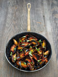 Rustic black mussel in tomato sauce Royalty Free Stock Image
