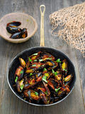 Rustic black mussel in tomato sauce Stock Photo