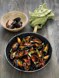 Rustic black mussel in tomato sauce Stock Images
