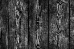 Rustic black and white wooden surface. Texture, background stock images