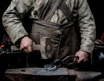 Rustic blacksmith forges item on the anvil Stock Photos