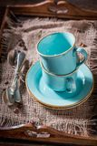 Rustic blue coffee cup on old burlap napkin Stock Photos