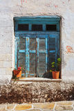 Rustic blue window in Halki, Naxos Island, Greece. Royalty Free Stock Images