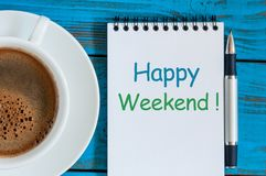 Rustic blue wooden desk with Notes About Happy Weekend with morning coffee cup Stock Photos