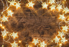 Rustic board with garland of stars. Stock Images