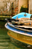 Rustic Boat. Old rustic boat on the water in italy filled stock photo