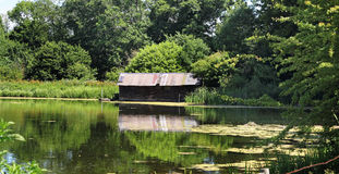 Rustic Boathouse on a tranquil lake Royalty Free Stock Photography