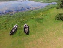 Rustic boats near the lake, Latvia in summer Royalty Free Stock Photo