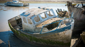 Rustic boats on a ship graveyards Stock Photo