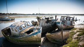 Rustic boats on a ship graveyards. Noirmoutier, France - April 28, 2016 : Rustic boats on a ship graveyards on Noirmoutier, France Stock Image