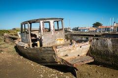 Rustic boats on a ship graveyards. Noirmoutier, France - April 28, 2016 : Rustic boats on a ship graveyards on Noirmoutier, France Royalty Free Stock Photos