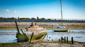 Rustic boats on a ship graveyards. Noirmoutier, France - April 28, 2016 : Rustic boats on a ship graveyards on Noirmoutier, France Royalty Free Stock Photo