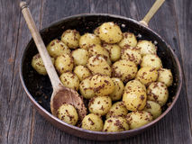 Rustic boiled potato in mustard Royalty Free Stock Photos