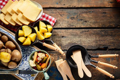 Rustic border of ingredients for raclette royalty free stock images