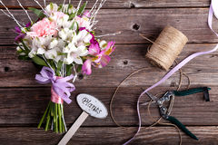 Rustic bouquet from gillyflowers and alstroemeria on old wooden Stock Photography