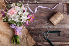 Rustic bouquet from gillyflowers and alstroemeria on old wooden Stock Photos