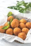 Rustic bowl of arancini. Close up Royalty Free Stock Photo