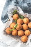 Rustic bowl of arancini. On the wooden table Royalty Free Stock Photos