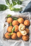 Rustic bowl of arancini. On the wooden table Stock Image