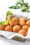 Rustic bowl of arancini. On the wooden table Stock Images
